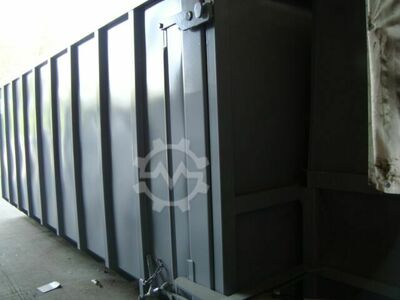 Rolling container to the stationary screw conveyor