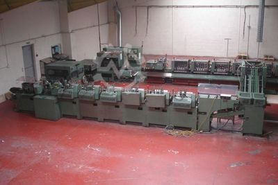 Saddle stitcher with feeder and cutting