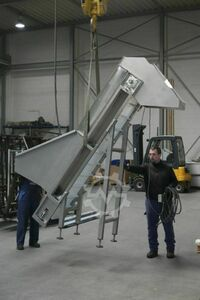 Stainless steel conveyor with chute