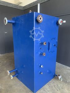 Heat exchanger, condensate collection tanks