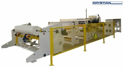 Wrapping machine for non-woven fabrics